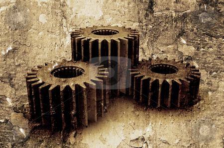 Grunge gears stock photo, Interlocking gears on textured grunge background by Kirsty Pargeter