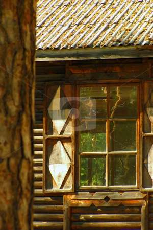 Window stock photo, Window with the opened shutters in a wooden frame, which the forest is visible through by Sergej Razvodovskij