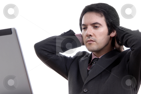 Bored stock photo, Young bored man and working with is laptop by Rui Vale de Sousa