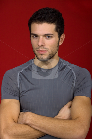 Young man stock photo, Portrait of sexy young man, against red background by Rui Vale de Sousa