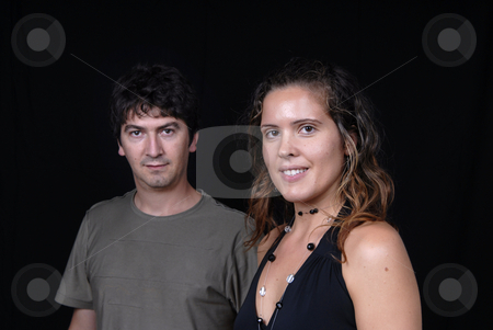 Casual stock photo, Young casual couple portrait in studio shot, focus on the woman by Rui Vale de Sousa