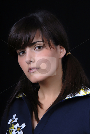 Woman stock photo, Young woman posing in black background in casual clothes by Rui Vale de Sousa