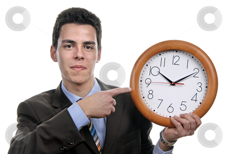 Clock stock photo, A handsome business man holding a clock by Rui Vale de Sousa