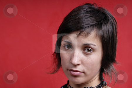 Woman stock photo, Young woman portrait isolated on red background by Rui Vale de Sousa