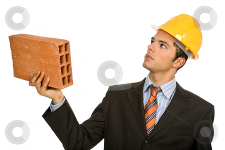 Brick stock photo, Young business man with a brick, on white by Rui Vale de Sousa