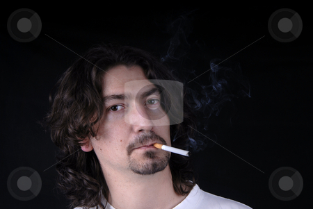 Smoker stock photo, Casual young man portrait posing with cigarette by Rui Vale de Sousa