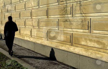 Walk stock photo, Man walking along the wall by Rui Vale de Sousa