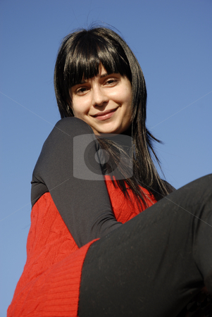Face stock photo, Casual latin girl outdoors with the sky in the background by Rui Vale de Sousa