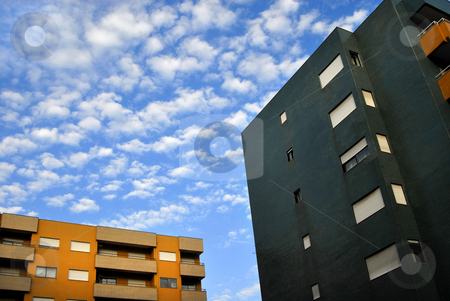 Buildings stock photo, Two buildings and the clouds in the sky by Rui Vale de Sousa