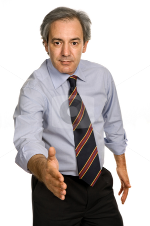 Shake stock photo, Mature man in suit offering to shake the hand by Rui Vale de Sousa
