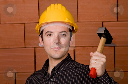 Foreman stock photo, Man with yellow hat with a brick wall as background by Rui Vale de Sousa
