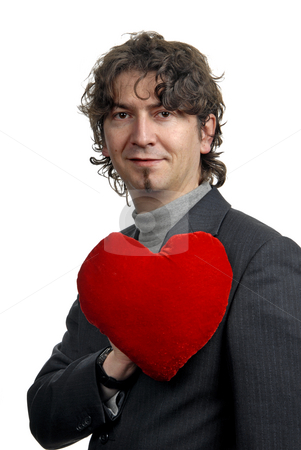 Love stock photo, Man holding a red heart in the hand. On white background by Rui Vale de Sousa