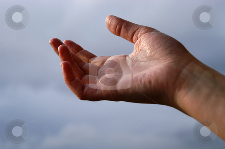 Reach stock photo, Human female hand with the sky as background by Rui Vale de Sousa