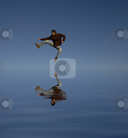 Youth stock photo, Young man jumps, water digitally worked reflection by Rui Vale de Sousa