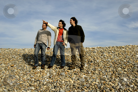 Pointing stock photo, Three young casual men at the beach by Rui Vale de Sousa