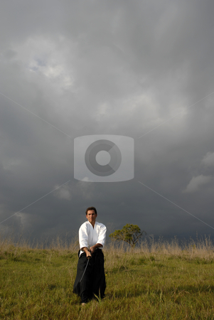 Aikido stock photo, Young aikido man with a sword outdoors by Rui Vale de Sousa