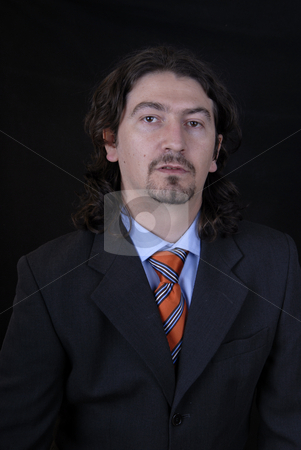 Portrait stock photo, Young business man portrait on black background by Rui Vale de Sousa