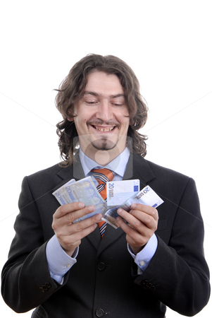Money stock photo, Business man holding money isolated on white by Rui Vale de Sousa