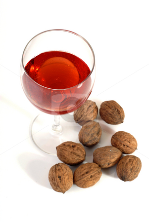 Wine stock photo, Wine glass with some nuts isolated on white by Rui Vale de Sousa