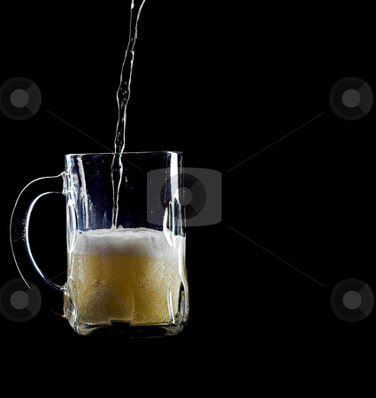 Pouring beer 2 stock photo, Pour beer into a glass mug by Matt Baker
