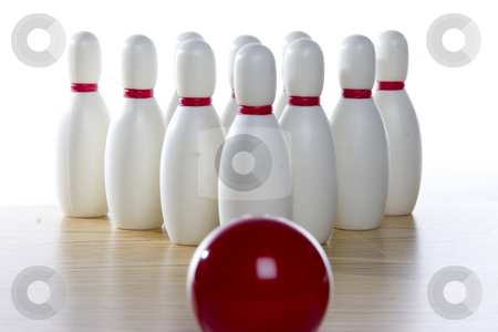 Bowling ball and pins stock photo, A bowling ball is lined up at the pins. Focus is centered on the pins. by Matt Baker