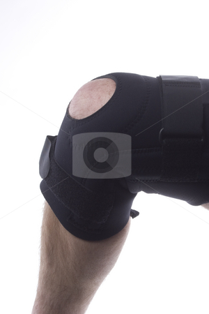 Knee Brace stock photo, A isolated image of a knee brace on a leg by Matt Baker