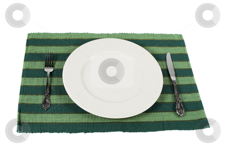 Place setting stock photo, A place setting knife,fork and plate by Matt Baker