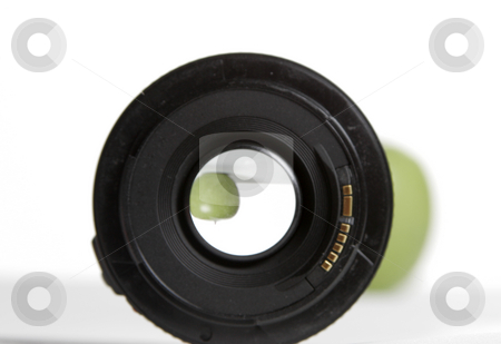 Looking through the lens stock photo, A apple comes into focus in the lens by Matt Baker