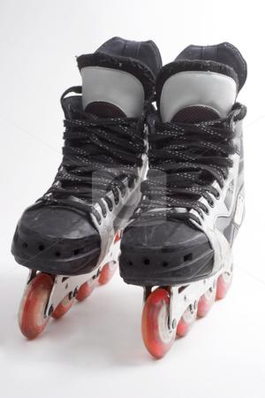 Inline hockey skates stock photo, A pair of mens inline hockey skates by Matt Baker