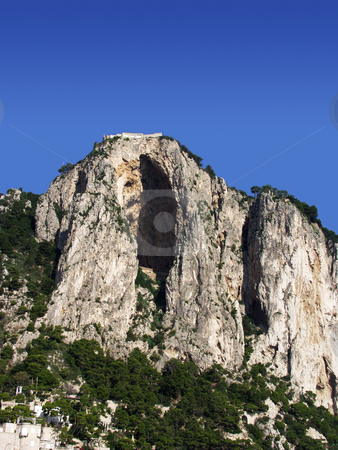 House on a cliff stock photo, A house sits on the edge of a cliff on the island of Capri by Matt Baker