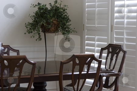 Dining Room stock photo, A shot of four chairs at the end of a dining room table by Matt Baker
