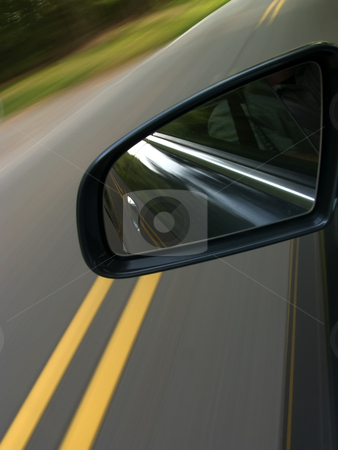 Car speeding down a road stock photo, A motion blur of a car speeding down a road by Matt Baker