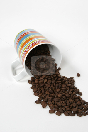 Coffee mug and beans stock photo, A coffee mug full of beans by Matt Baker