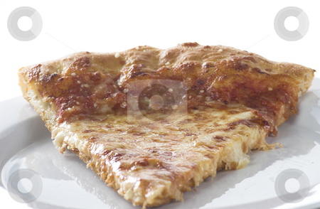 Slice of pizza stock photo, A slice of pizza sits on a plate by Matt Baker
