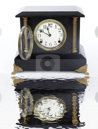Mantel Clock stock photo, An old mantel clock and it's reflection in water by Matt Baker
