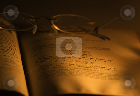 Engineering Book stock photo, An old engineering book lit by candle light by Matt Baker