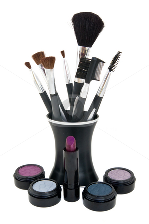 Various cosmetics with application brushes stock photo, Eye shadow, blush and lipstick with application brushes in stand, all isolated against a white backgrounds. by Steve Carroll