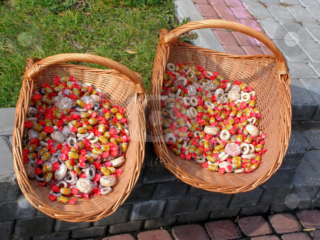 Candies on the street stock photo, Two baskets with candy and honey cakes at the street by Sergej Razvodovskij