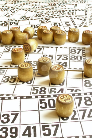 Bingo stock photo, Lotto cards and small lotto-casks with figures by Sergej Razvodovskij