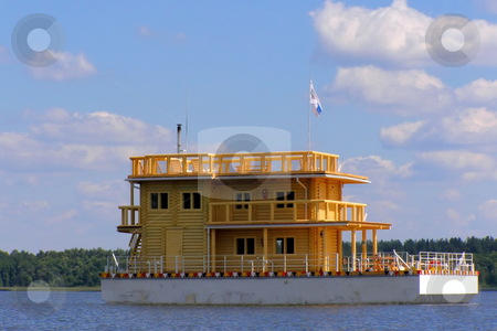 House on the water stock photo, House from beam on the water against cloudy sky by Sergej Razvodovskij