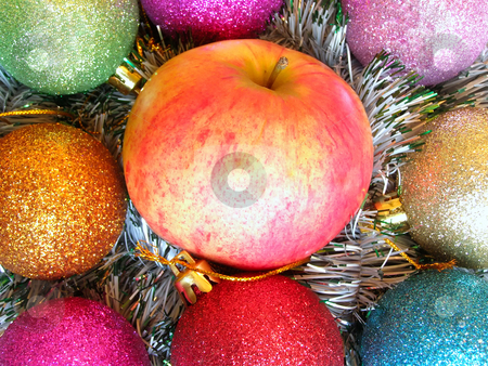 Christmas apple stock photo, Apple among varicolored christmas-tree decorations by Sergej Razvodovskij