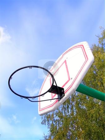 Backboard stock photo, Basketball basket without net against of blue sky by Sergej Razvodovskij