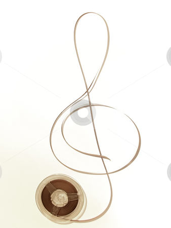 Old music in sepia stock photo, Reel with old music and tape in the form of a treble clef by Sergej Razvodovskij