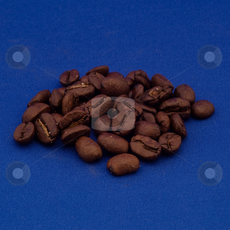 Coffee beans stock photo, A coffee bean is the seed of the coffee plant (the pit inside the red or purple fruit). The fruits, coffee cherries or coffee berries, most commonly contain two stones with their flat sides together. by Mariusz Jurgielewicz