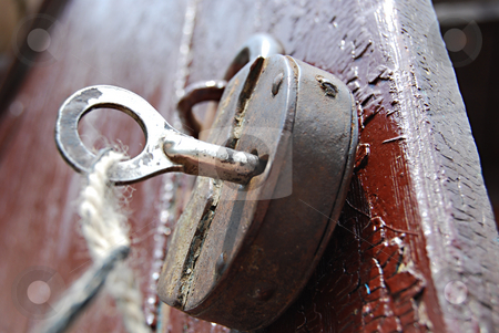 Old lock stock photo, Iron key stuck in the old rusty lock by Leyla Akhundova
