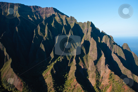 Wrinkled cliff face on Na Pali coast in Kauai stock photo, Close up of the rock face on the Na Pali coast on the north of Kauai by Steven Heap