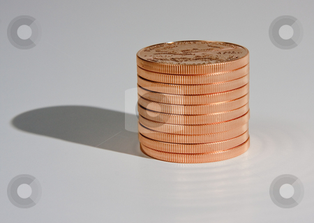 Stack of one ounce gold coins stock photo, Stack of ten one ounce gold eagle coins with a shadow by Steven Heap