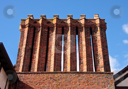 Six chimney stacks on old house stock photo, Ancient chimney stacks on old tudor house in England by Steven Heap