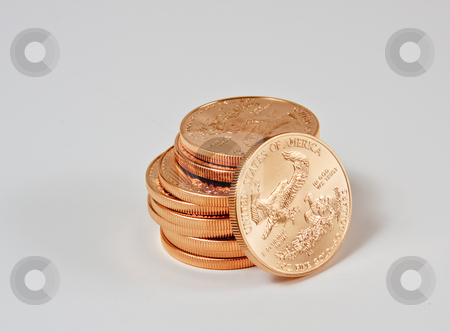 Stack of 1 ounce gold coins stock photo, 1 Ounce gold eagle coins in a stack with one coin loose by Steven Heap