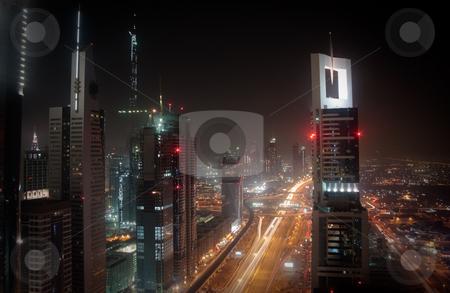 Cityscape of Dubai stock photo, Towering city skyscraper blocks in Dubai with view of Burj by Steven Heap